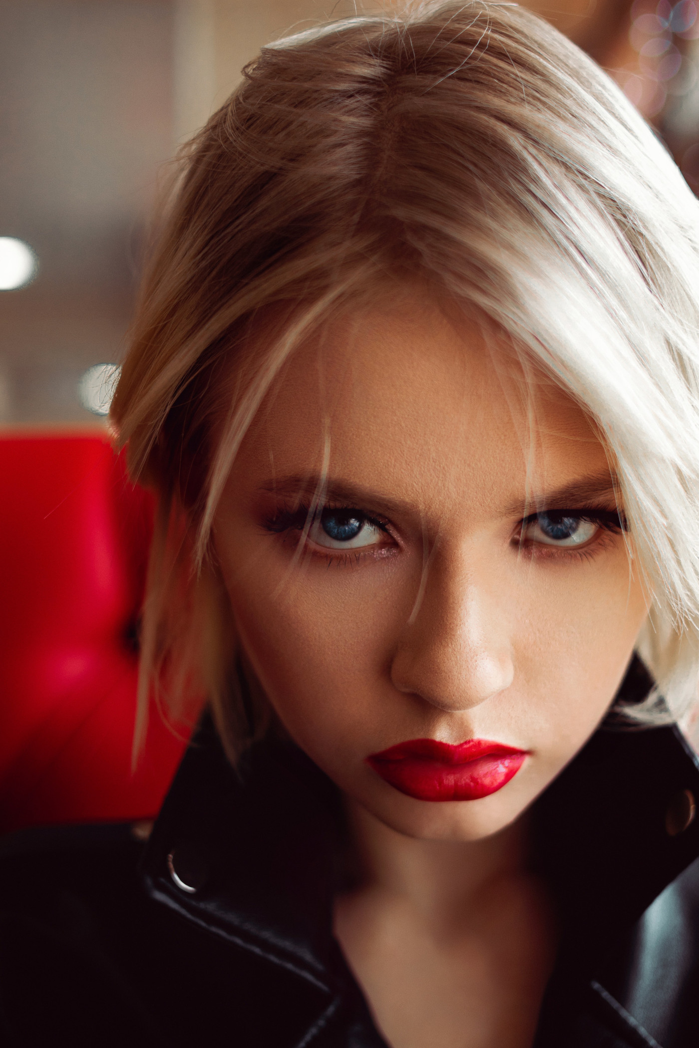 Angry looking girl in red lipstick